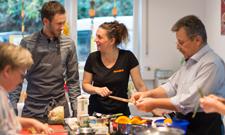 Vom Tellerwaschen zur eigenen Kochschule
